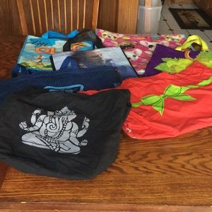 REUSABLE BAGS BUNDLE OF VARYING SIZES.